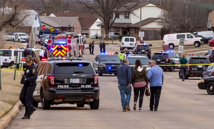 Emergency crews respond to a scene where a vehicle hit several Moore High School students, killing at least one, in Moore, Okla., .