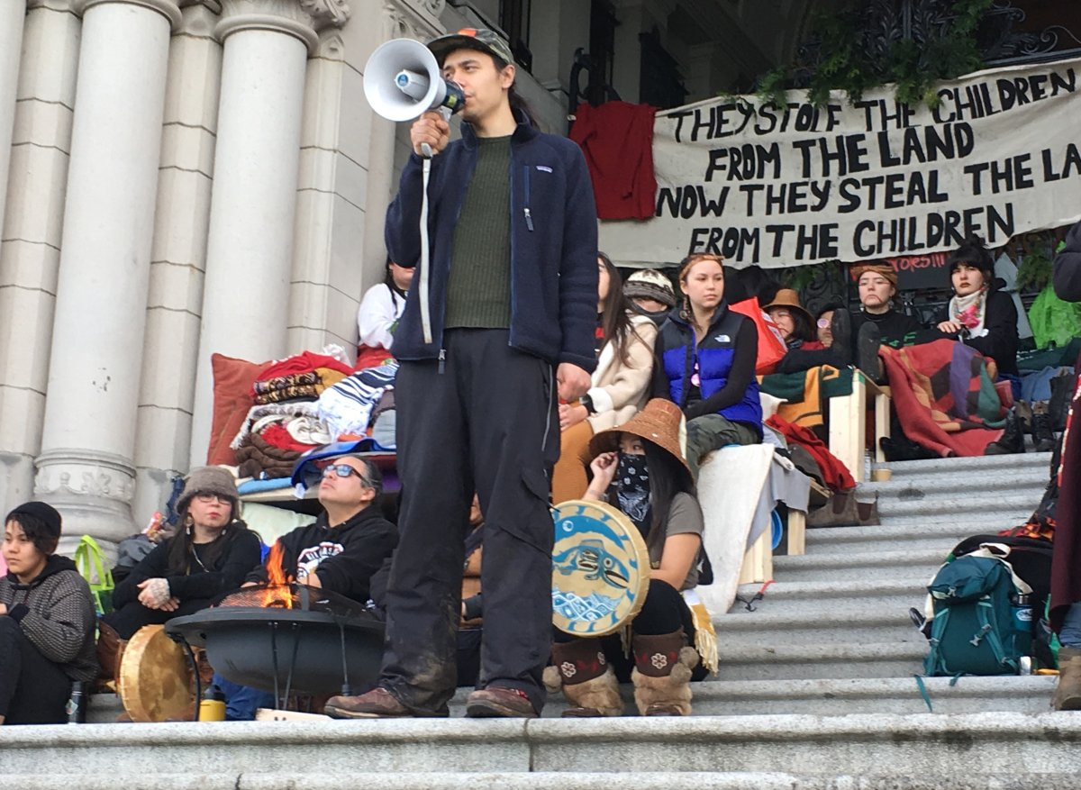 Indigenous pipeline protester Kolin Sutherland-Wilson speaks at an anti-pipeline rally in Victoria, Saturday, Feb. 8, 2020.