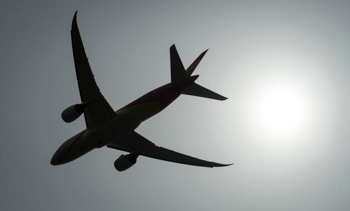 A plane is silhouetted as it takes off from Vancouver International Airport in Richmond, B.C., Monday, May 13, 2019.
