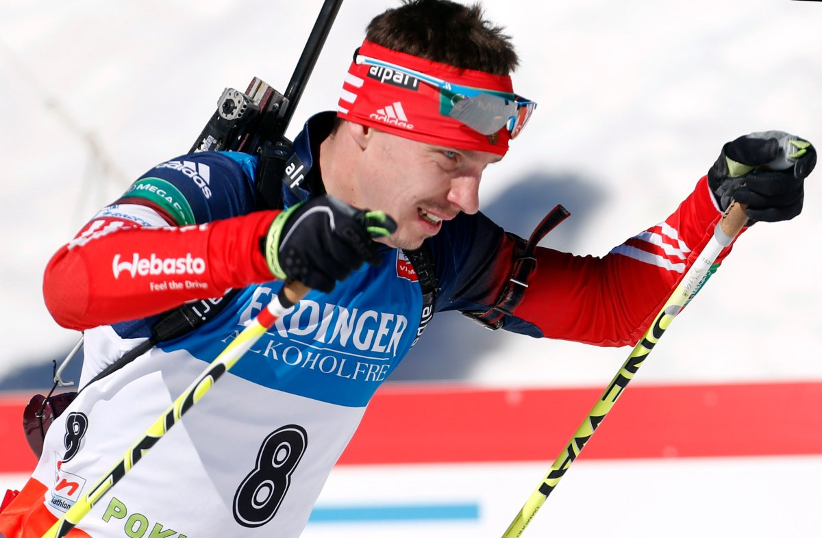 In this file photo dated Sunday, March 9, 2014, Russia's Evgeny Ustyugov competes in the men's 15km mass start at the biathlon World Cup competition in Pokljuka, Slovenia. The International Biathlon Union on Saturday Feb. 15, 2020, issued a two-year ban for Russia's Evgeny Ustyugov, who was part of the gold medal-winning men's relay team at the 2014 Sochi Winter Olympics.