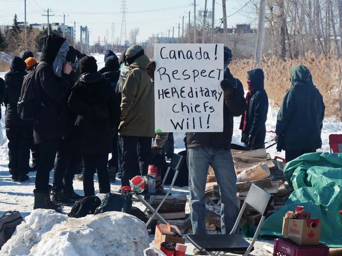 People protest at a rail blockade in St-Lambert, south of Montreal, Que. on Thursday, February 20, 2020 in solidarity with the Wet'suwet'en hereditary chiefs opposed to the LNG pipeline in northern British Columbia.