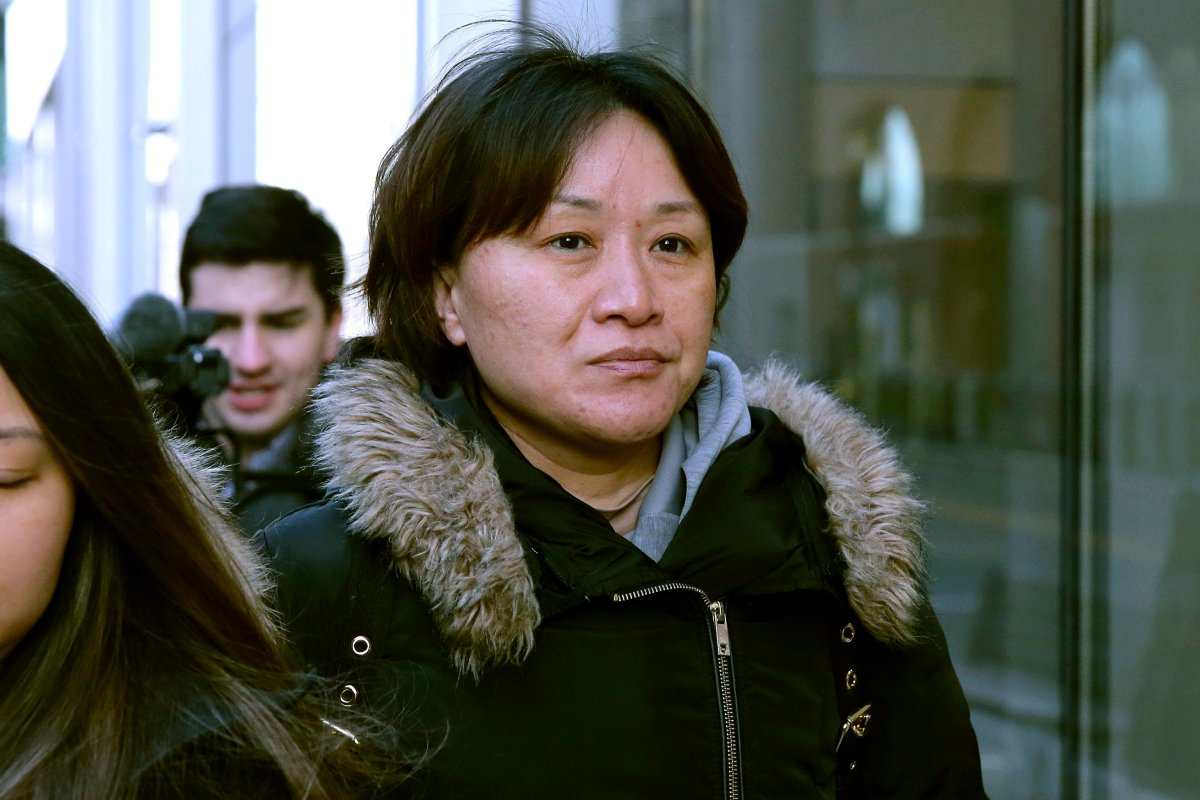 Xiaoning Sui, a Chinese national residing in British Columbia, Canada, leaves federal court, Friday, Feb. 21, 2020, in Boston, after pleading guilty to paying $400,000 to get her son into the University of California, Los Angeles, as a fake soccer recruit.