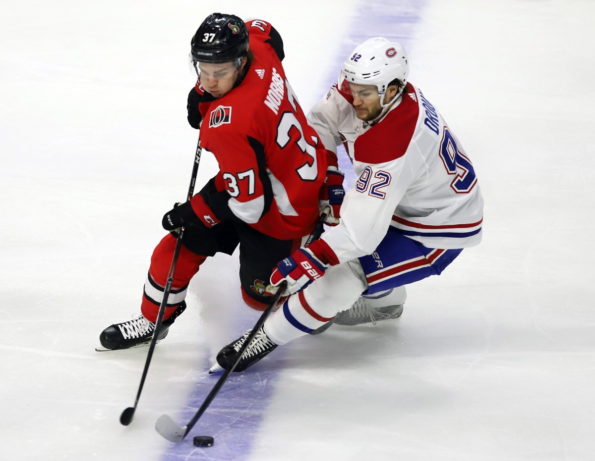 Ottawa Senators centre Josh Norris (37) and Montreal Canadiens left wing Jonathan Drouin (92) battle for the puck during first period NHL action in Ottawa on Saturday, Feb. 22, 2020.