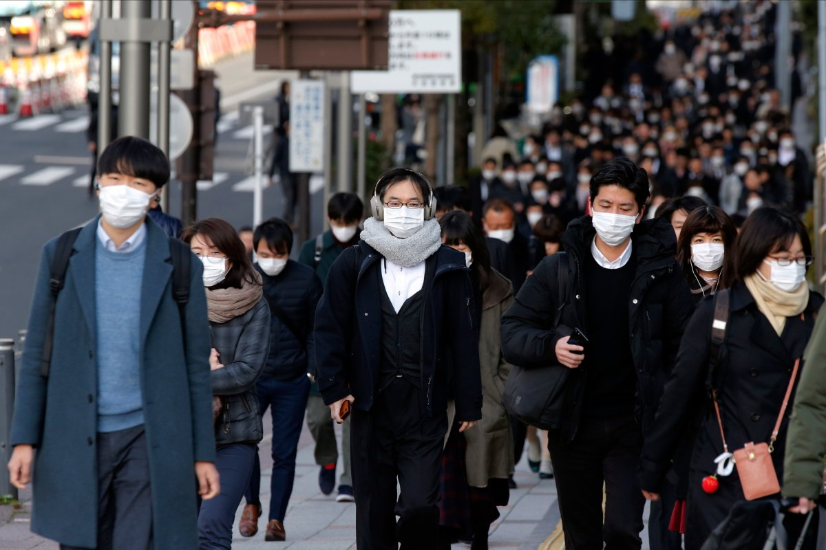 In this Feb. 20, 2020, photo, people wear masks as they commute during the morning rush hour, in Chuo district in Tokyo.