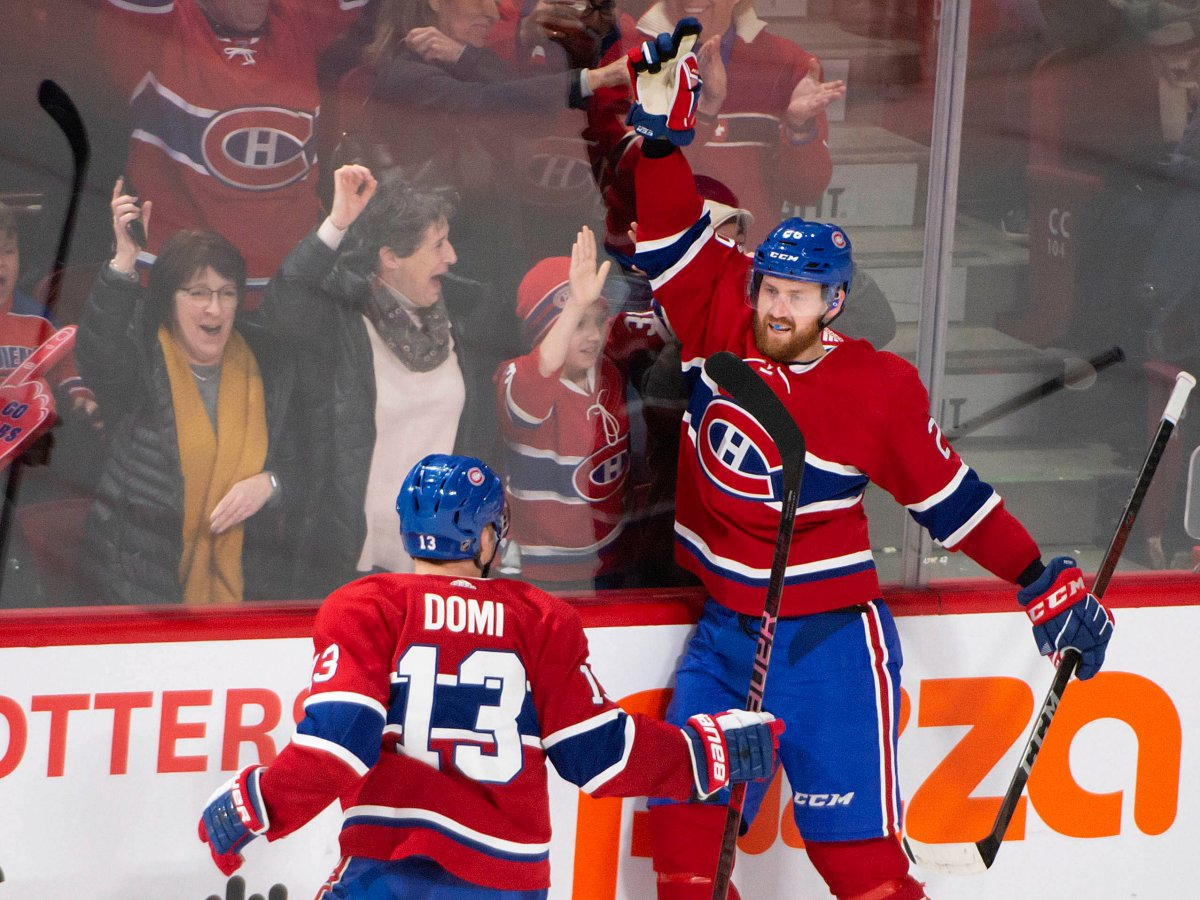 Montreal Canadiens defenceman Jeff Petry (26) celebrates his goal with teammate Montreal Canadiens centre Max Domi (13) during overtime NHL hockey action against the Carolina Hurricanes, in Montreal, Saturday, Feb. 29, 2020.