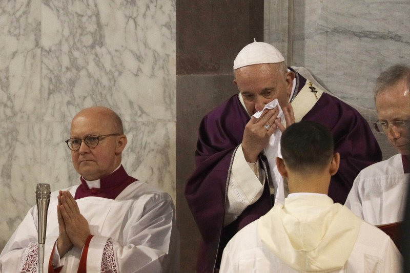 In this picture taken Wednesday, Feb. 26, 2020, Pope Francis wipes his nose during the Ash Wednesday Mass opening Lent, the forty-day period of abstinence and deprivation for Christians before Holy Week and Easter, inside the Basilica of Santa Sabina in Rome. Pope Francis is sick and skipped a planned Mass with Rome clergy across town on Thursday, Feb. 27, 2020, officials said.