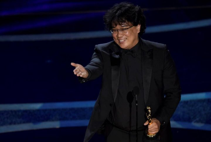 """Bong Joon Ho accepts the award for best director for """"Parasite"""" at the Oscars on Sunday, Feb. 9, 2020, at the Dolby Theatre in Los Angeles."""