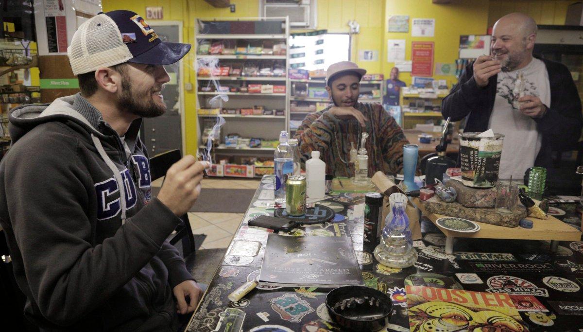 Daniel Jordan, of Tampa, Fla., left, Giobanni Turner, St. Albans, N.Y., center, and Frankie Turck , of Denver, smoke marijuana at iBake smoking lounge on Tuesday, April 25, 2017 in Denver.