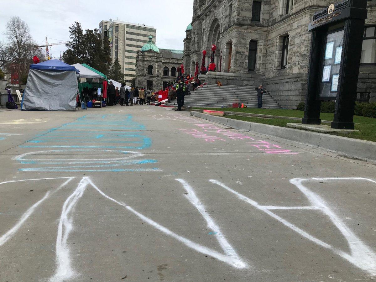 Chalk is sprayed on the walkways at the B.C. Legislature.