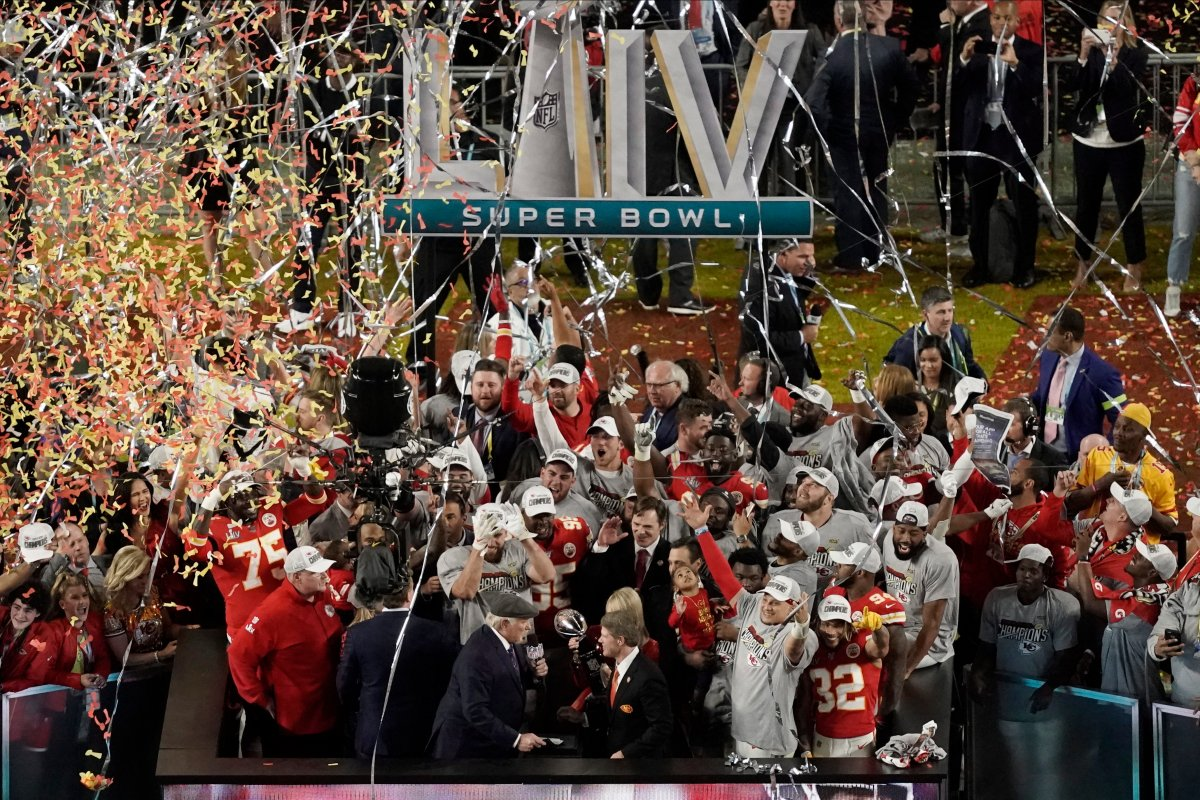 NFL Hall of Fame player Terry Bradshaw congratulates Kansas City Chiefs owner Clark Hunt and Norma Hunt after the team won Super Bowl 54 on Sunday, Feb. 2, 2020, in Miami Gardens, Fla.