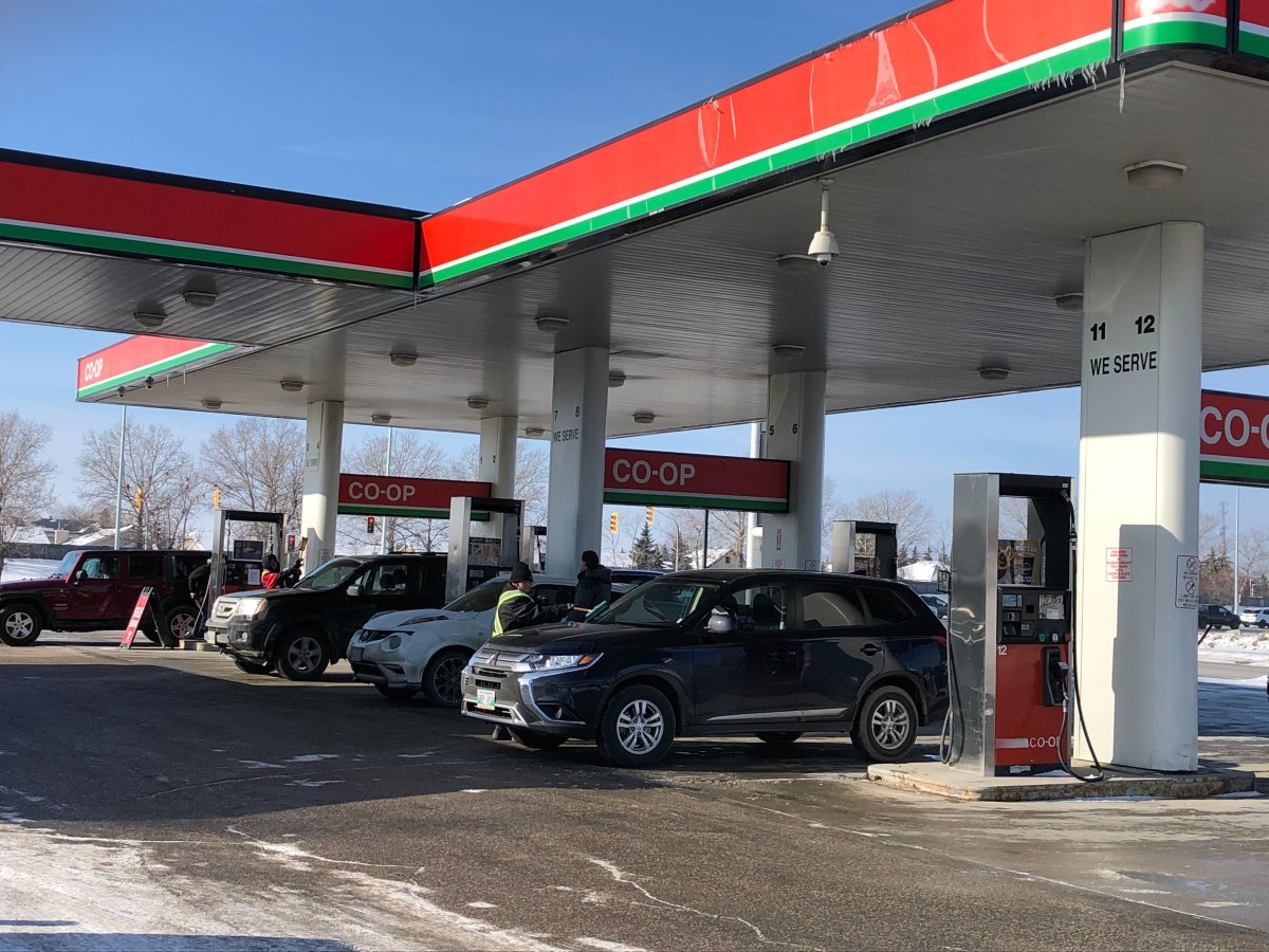 Customers are seen filling up at the Co-op gas station at 1745 Kenaston Blvd., in Winnipeg early Sunday afternoon.