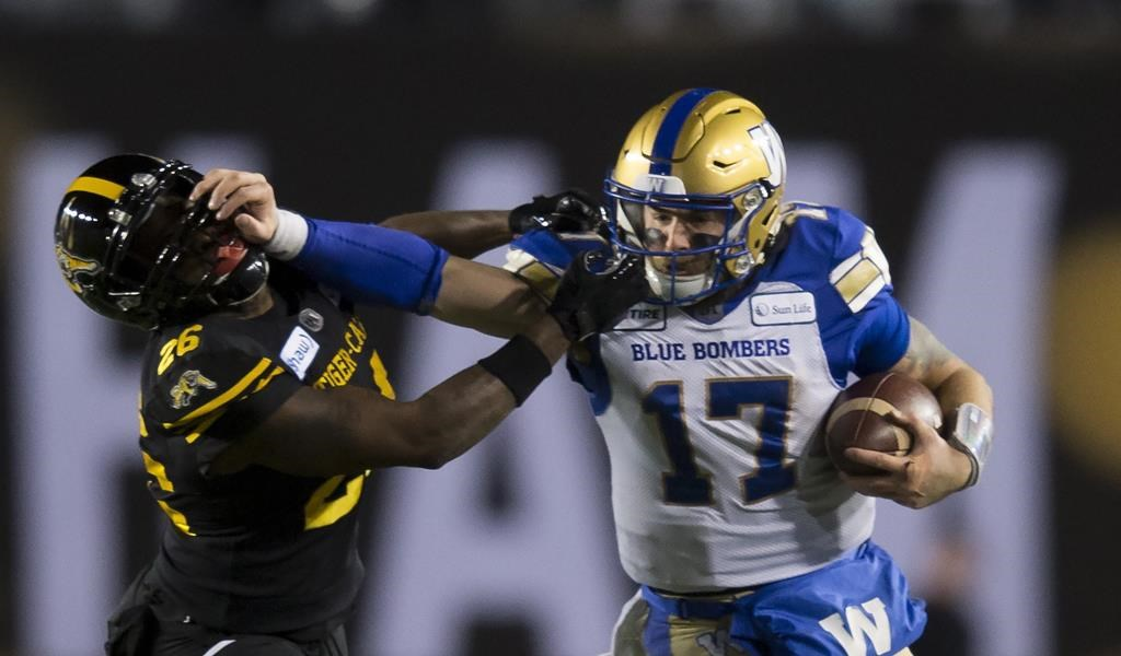 Winnipeg Blue Bombers quarterback Chris Streveler pushes away Hamilton Tiger-Cats' Cariel Brooks during the second half of the 107th Grey Cup in Calgary on November 24, 2019. The Winnipeg Blue Bombers released American quarterback Chris Streveler on Monday so he could pursue NFL opportunities. Streveler, 25, was scheduled to become a free agent Feb. 11. THE CANADIAN PRESS/Todd Korol.