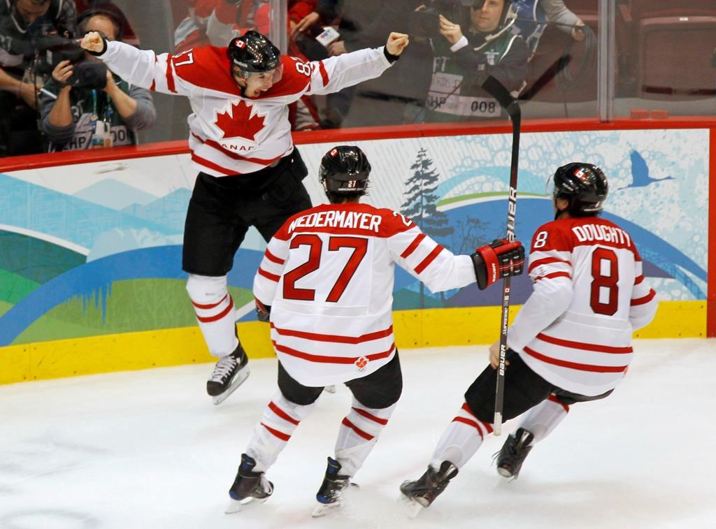 Canada's Sidney Crosby celebrates his game winning goal with Scott Niedermayer and Drew Doughty during overtime period men's ice hockey gold medal final at the 2010 Winter Olympic Games in Vancouver on February 28, 2010. Friday marks the 10th anniversary of Sidney Crosby's memorable overtime goal that lifted Canada past the United States 3-2 in the men's hockey final at the 2010 Vancouver Olympics. THE CANADIAN PRESS/Paul Chiasson.