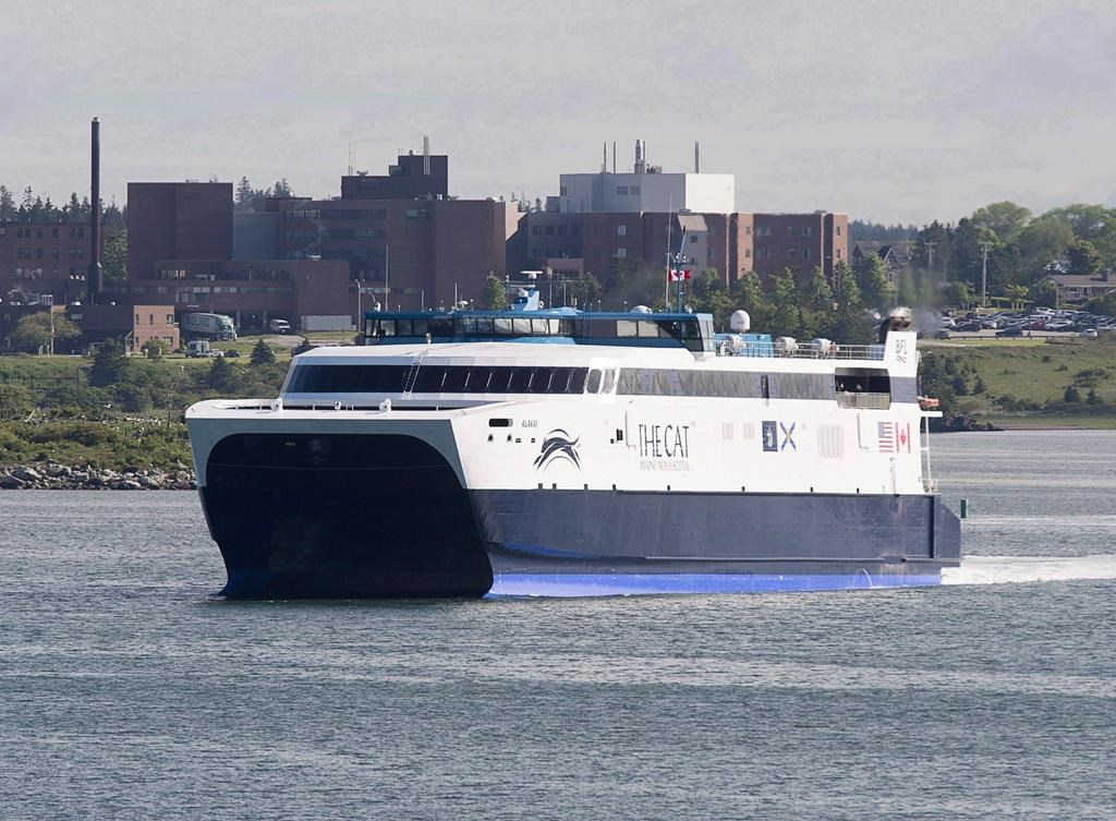 The CAT, a high-speed passenger ferry, departs Yarmouth, N.S. heading to Portland, Maine, on its first scheduled trip on Wednesday, June 15, 2016.