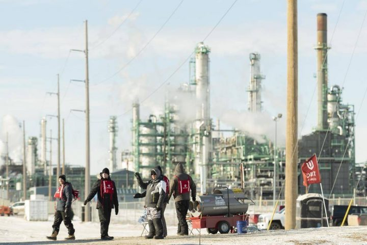 Unifor 594 members walk the picket line at the Co-op Refinery in Regina on Tuesday January 21, 2020. Regina police have arrested four more people involved in a labour dispute at the Co-op oil refinery. THE CANADIAN PRESS/Michael Bell.