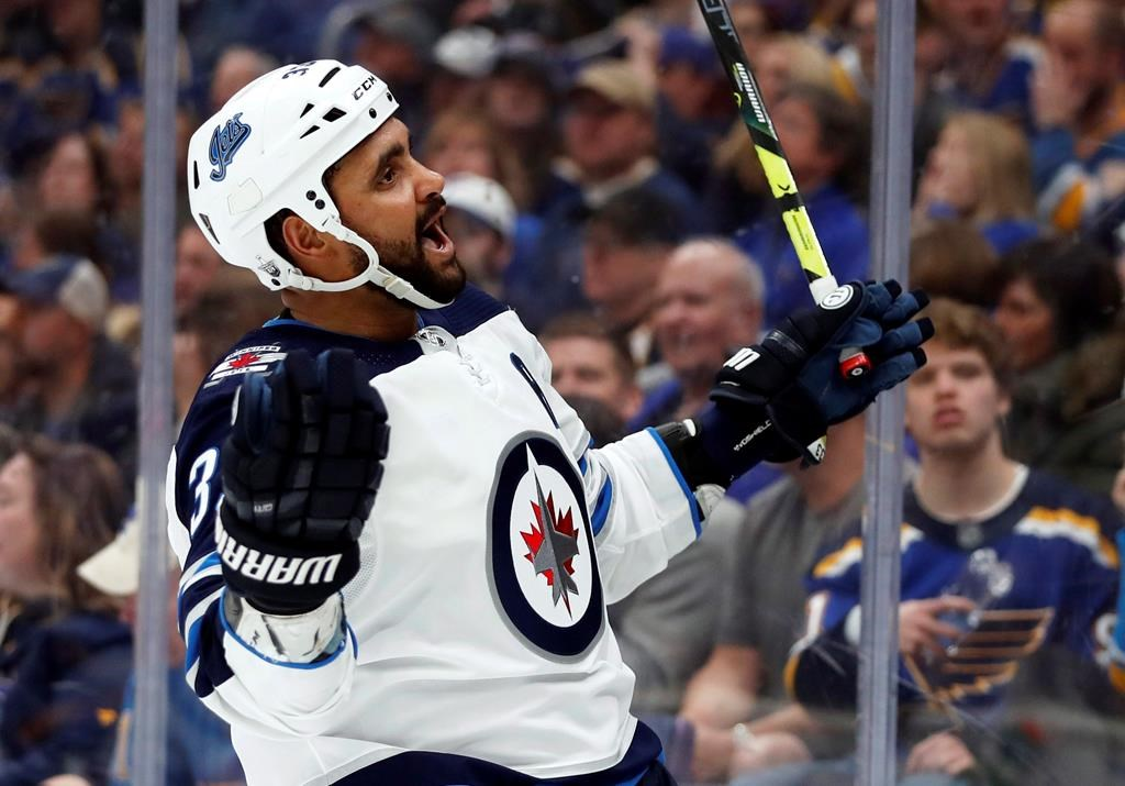 The Winnipeg Jets' Dustin Byfuglien celebrates after scoring during the third period in Game 3 of an NHL first-round hockey playoff series against the St. Louis Blues on Sunday, April 14, 2019, in St. Louis.