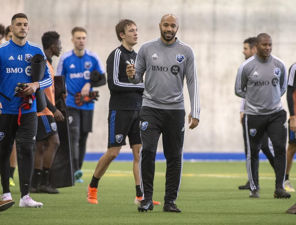 Montreal Impact head coach Thierry Henry, centre, conducts his first practice Tuesday, January 14, 2020 in Montreal. THE CANADIAN PRESS/Ryan Remiorz.