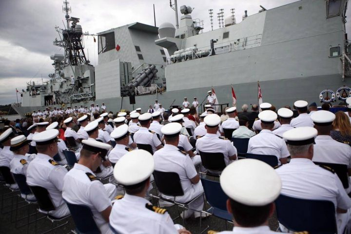 The HMCS Calgary is seen behind sailors during a change of command ceremony at CFB Esquimalt, in Esquimalt, B.C., Wednesday, June 24, 2015. The Royal Canadian Navy and Canadian Coast Guard say they hundreds more sailors as recruitment has failed to keep pace with attrition.THE CANADIAN PRESS/Chad Hipolito.