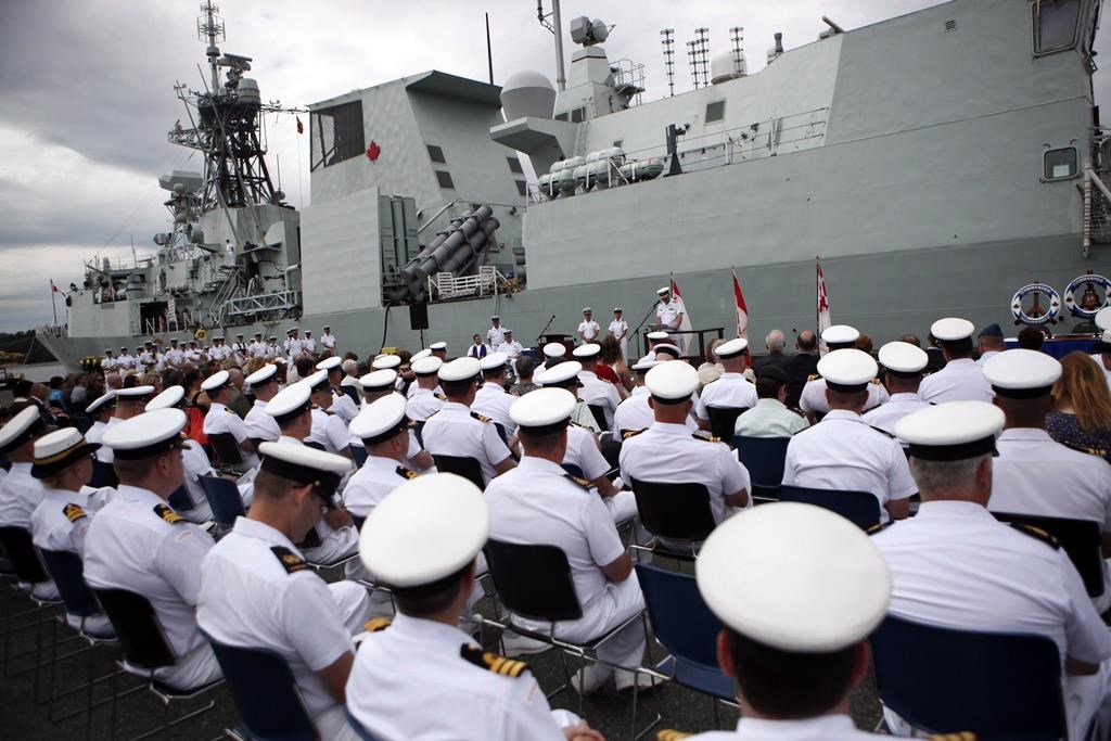 The HMCS Calgary is seen behind sailors during a change of command ceremony at CFB Esquimalt, in Esquimalt, B.C., Wednesday, June 24, 2015.