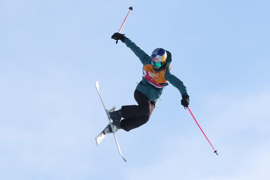 Eileen Gu, of China, competes during a run in the finals of the women's slopestyle at a World Cup freestyle skiing event in Calgary, Alberta on Saturday, Feb. 15, 2020.