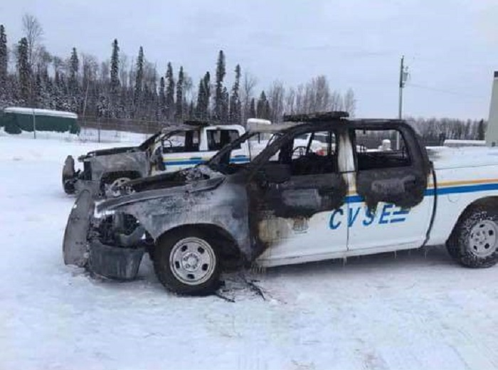A pair of burned-out CVSE vehicles seen in Fort Nelson, B.C.