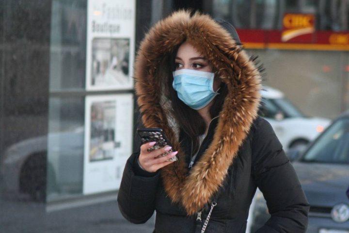 A pedestrian wears a face mask in Toronto on Jan. 29, 2020.