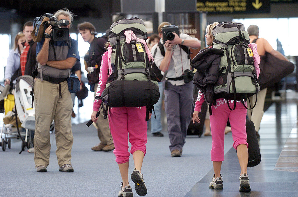 A couple participating in 'The Amazing Race' is caught on camera in the Denver airport.