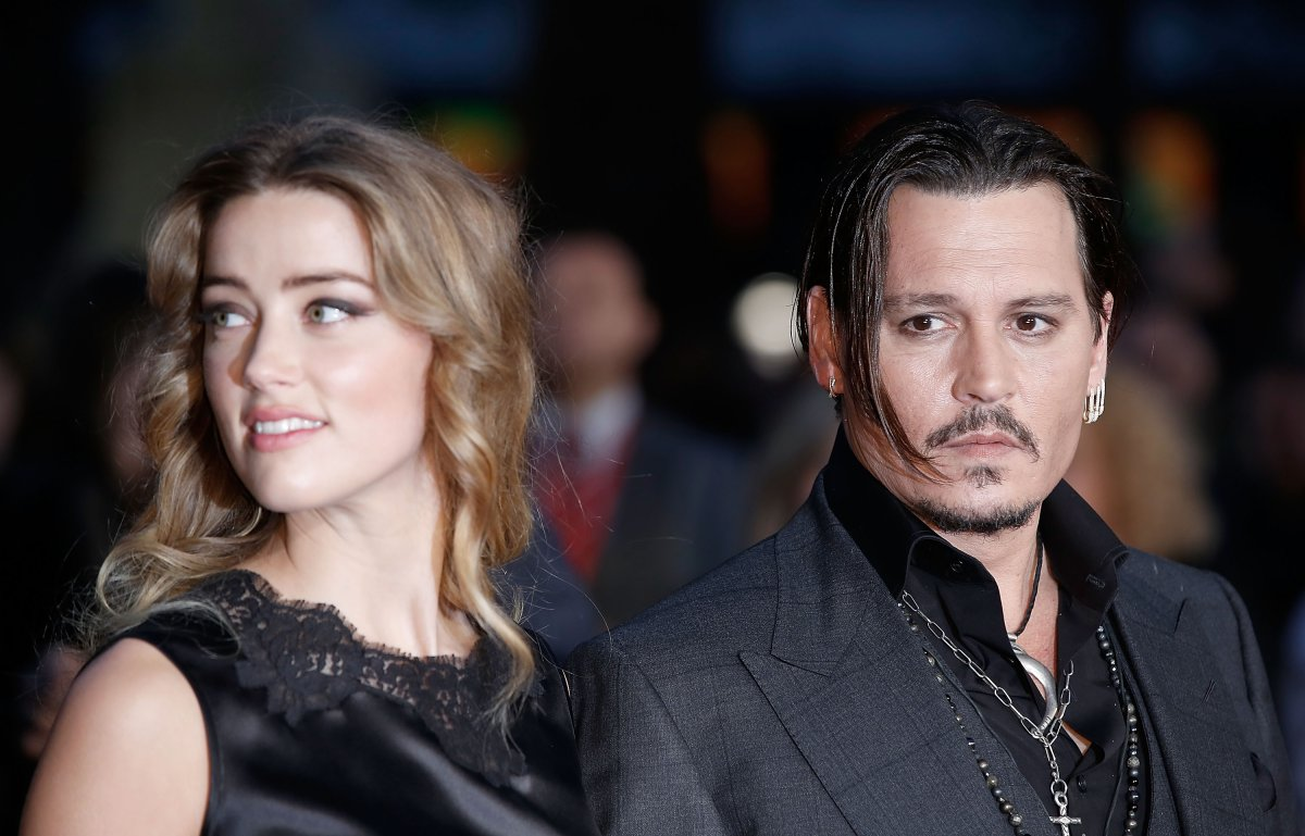 Amber Heard and Johnny Depp attend the 'Black Mass' Virgin Atlantic Gala screening during the BFI London Film Festival, at Odeon Leicester Square on Oct. 11, 2015 in London, England.