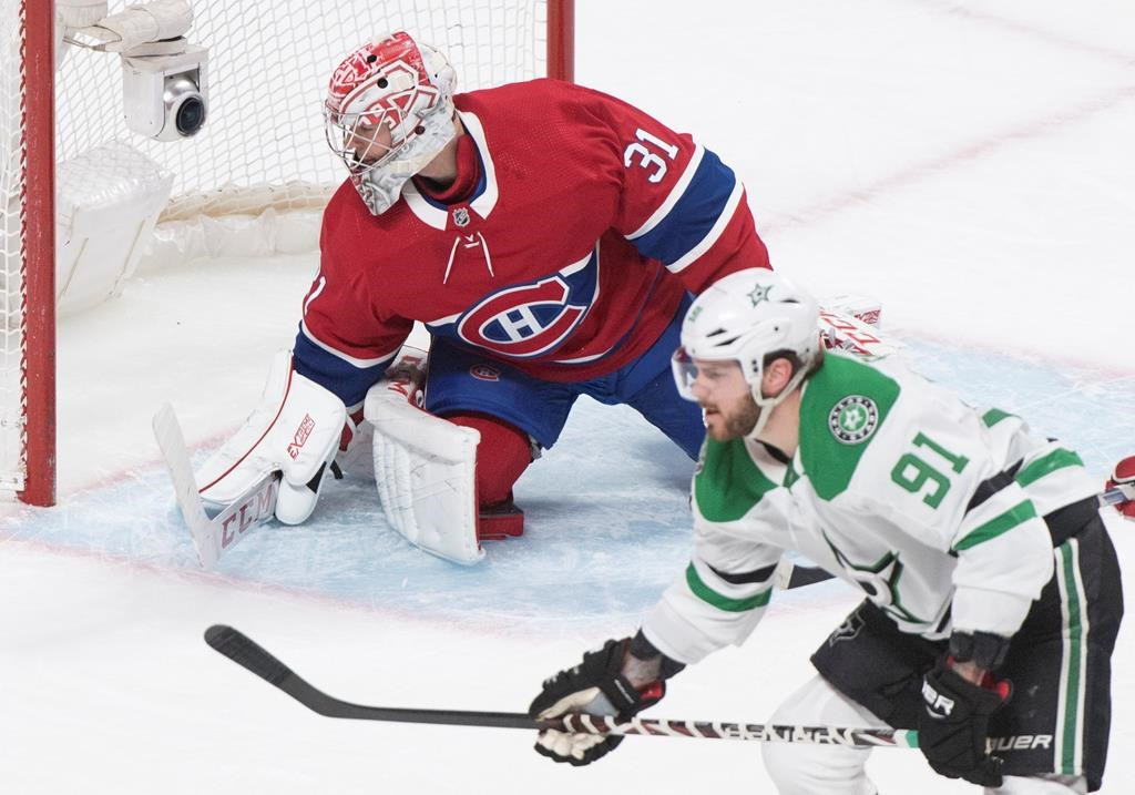 Montreal Canadiens goaltender Carey Price is scored on by Dallas Stars' Tyler Seguin (91) during overtime NHL action in Montreal, Saturday, Feb. 15, 2020.
