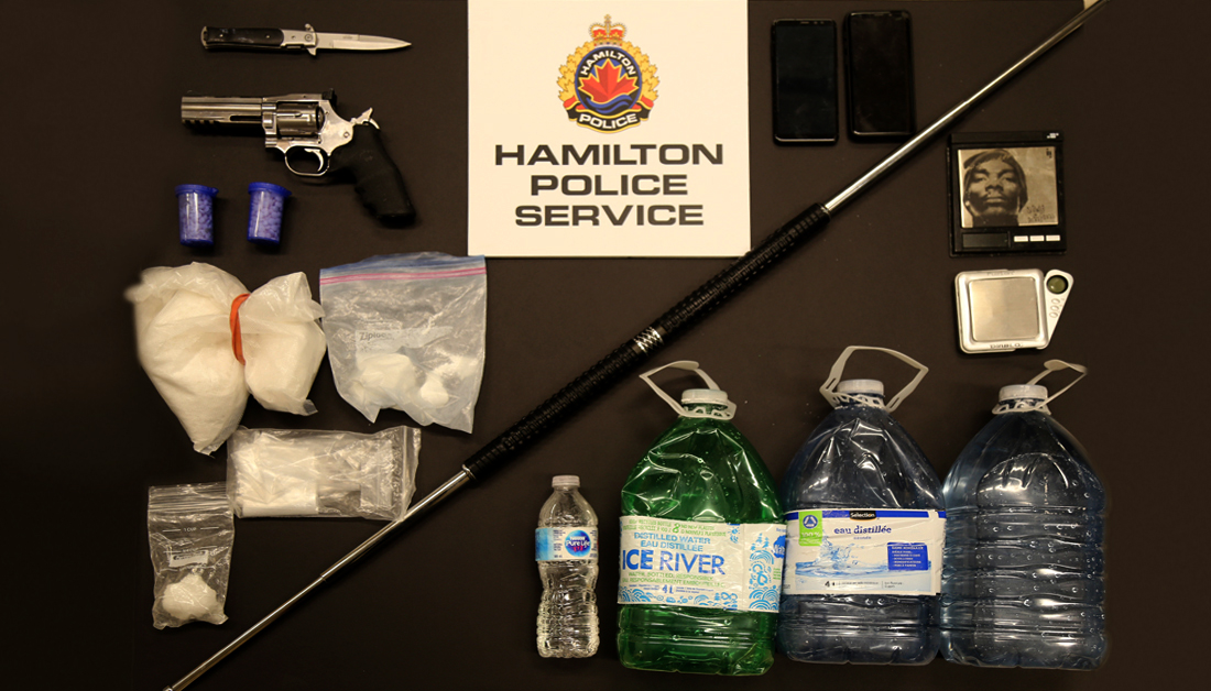 Hamilton Police say they seized weapons, cash and about $100,000 in cocaine and other drugs from a Grimsby home on Feb 12, 2020.