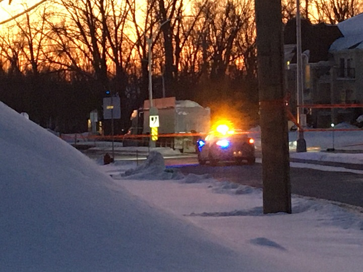 A snow removal truck involved in a collision with a pedestrian in Laval is parked on the side of the road. Friday, Feb. 14, 2020.