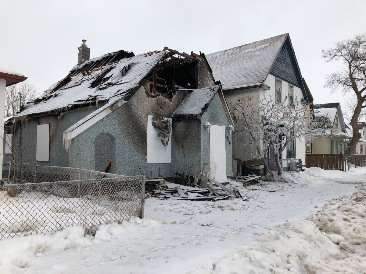 A gaping hole was left in the roof of a Weston home after a house fire. Michael Draven/Global News.