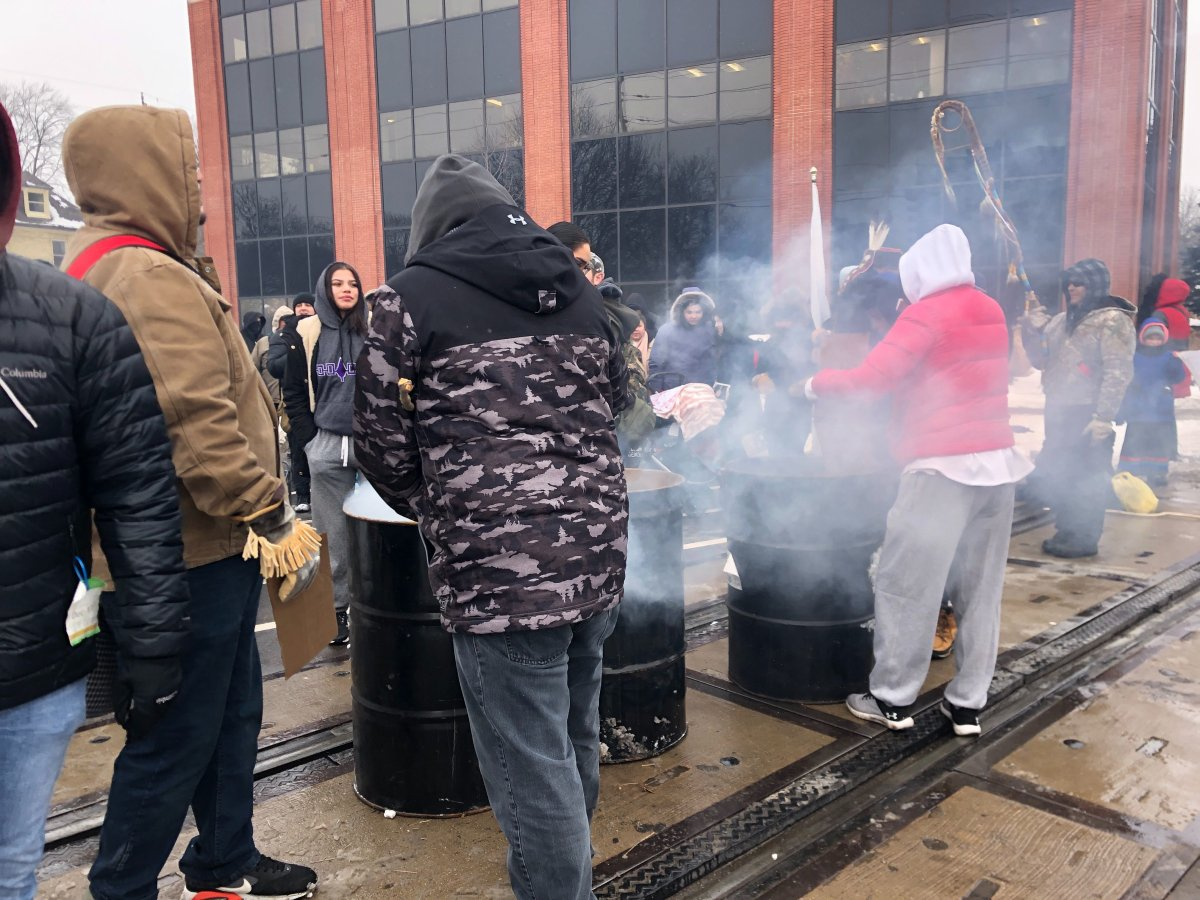 Demonstrators stopped at the train tracks in the area of Waterloo and Pall Mall streets in London, Ont. on Feb. 28, 2020.