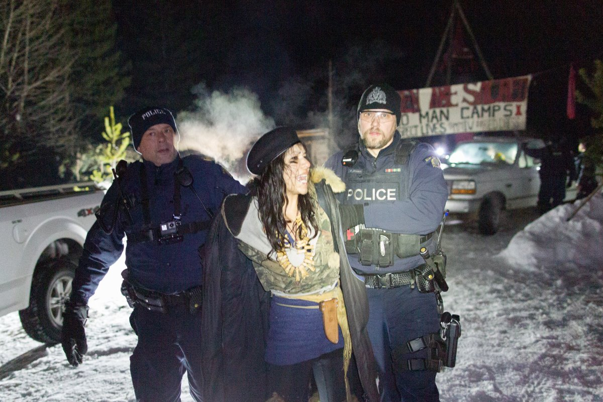RCMP make an arrest as they enforce an injunction over a contested natural gas pipeline near Houston, B.C.