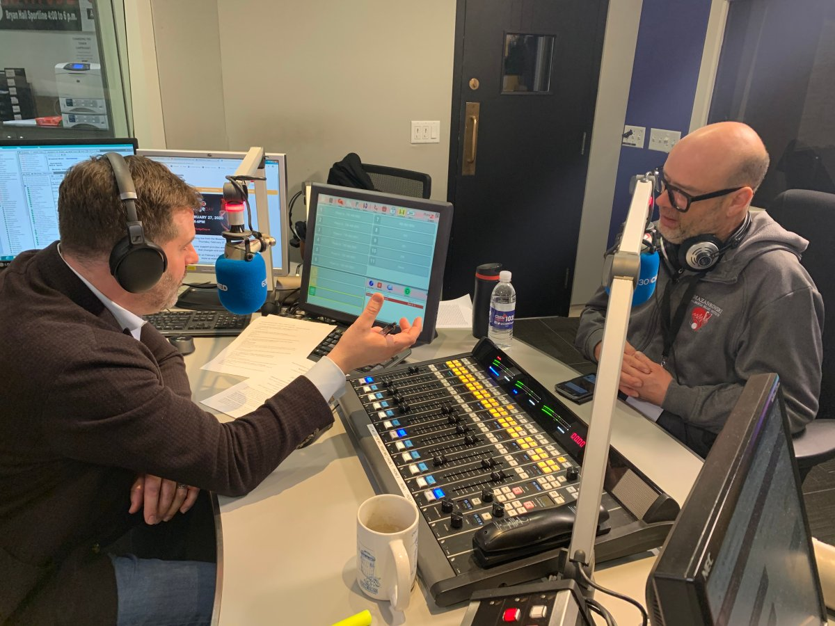 Ryan Jespersen speaks with chef Brad Smoliak as the two auction off a dinner package to raise money for the Mazankowski Alberta Heart Institute ahead of 630 CHED Heart Pledge Day.