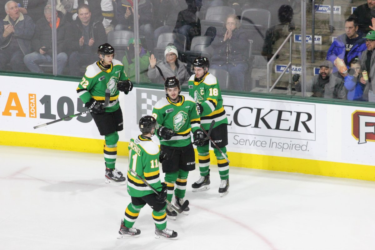 Ryan Merkley of the London Knights (28) is congratulated after scoring a goal by teammates Alec Regula (72), Liam Foudy (18) and Connor McMichael (11).