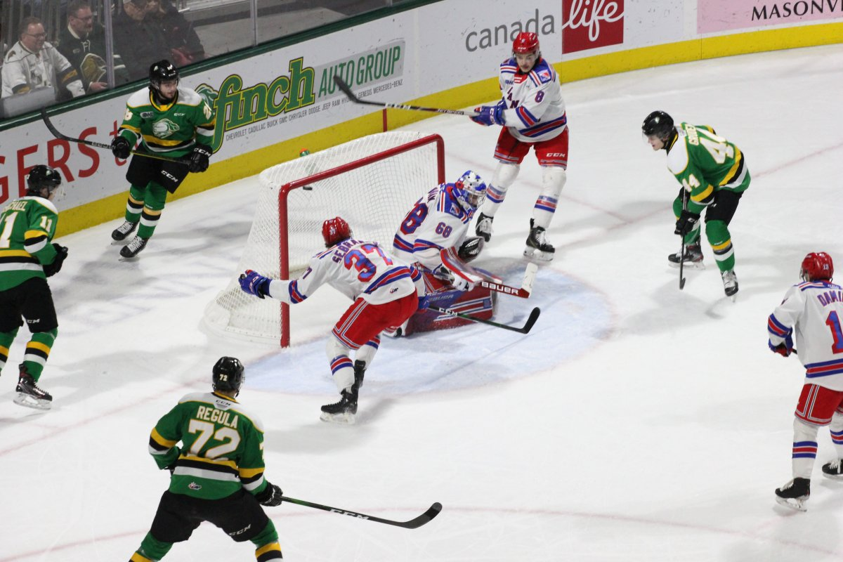 London, Ont. - Jonathan Gruden (44) watches as his shot tucks under the crossbar and into the Kitchener net in a 6-3 London Knights win over the Rangers on February 14, 2020.