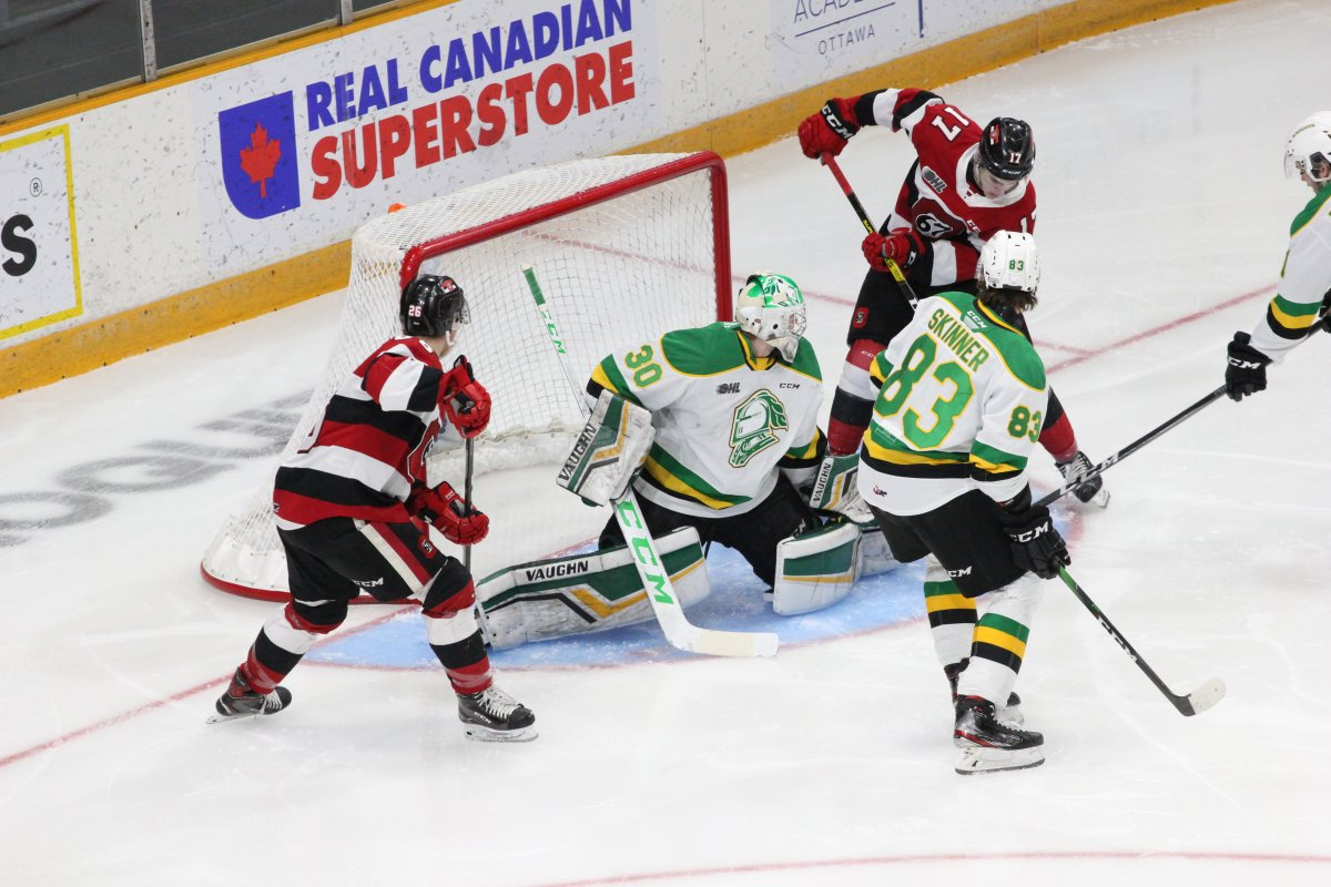 London Knights goaltender Brett Brochu lunges a leg across the crease to make a save against the Ottawa 67's.