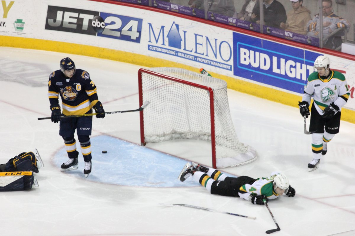 Jonathan Gruden of the London Knights lies on the ice after a swim-style celebration as he and the Knights defeated the Erie Otters 6-3 at the Erie Insurance Arena on March 1, 2020.