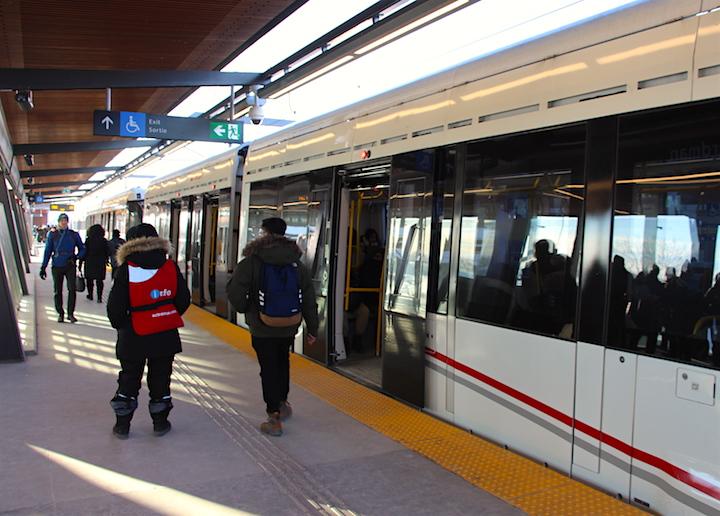 An OC Transpo train is seen on Line 1.