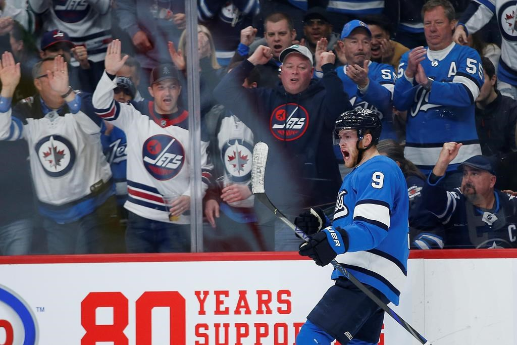 Winnipeg Jets' Andrew Copp (9) celebrates his goal against the St. Louis Blues during second period NHL action in Winnipeg on Saturday, February 1, 2020. THE CANADIAN PRESS/John Woods.