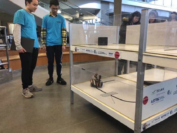 Two students at Okanagan College's annual Western Canada RoboCup Junior games on Friday.