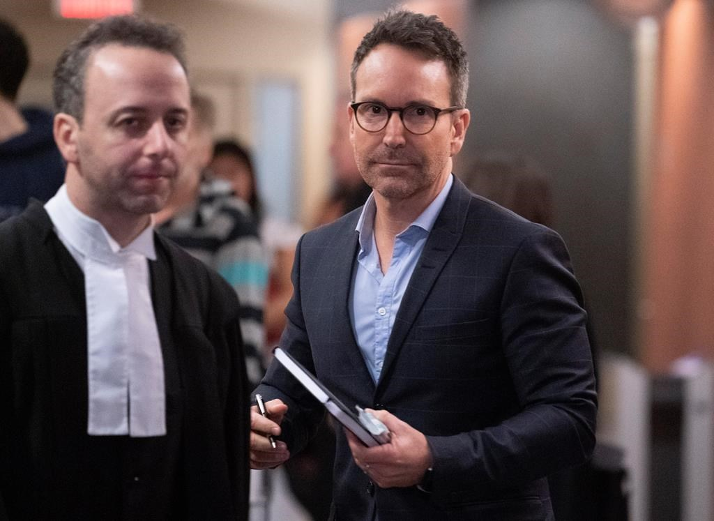 Former radio and television personality Eric Salvail walks the halls of the courthouse in Montreal on Monday, February 17, 2020. THE CANADIAN PRESS/Paul Chiasson.