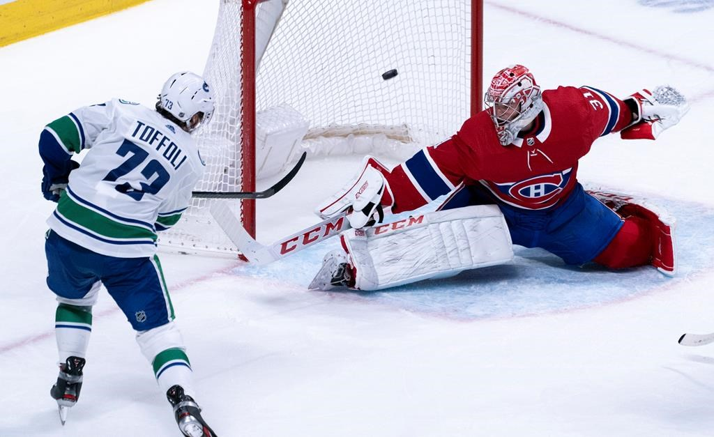 Vancouver Canucks' Tyler Toffoli scores past Montreal Canadiens goaltender Carey Price during overtime NHL hockey action in Montreal, Tuesday, Feb. 25, 2020. THE CANADIAN PRESS/Paul Chiasson.