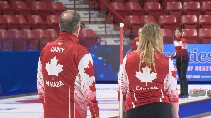 Dan and Chelsea Carey discuss strategy during practice at the 2020 Scotties Tournament of Hearts.
