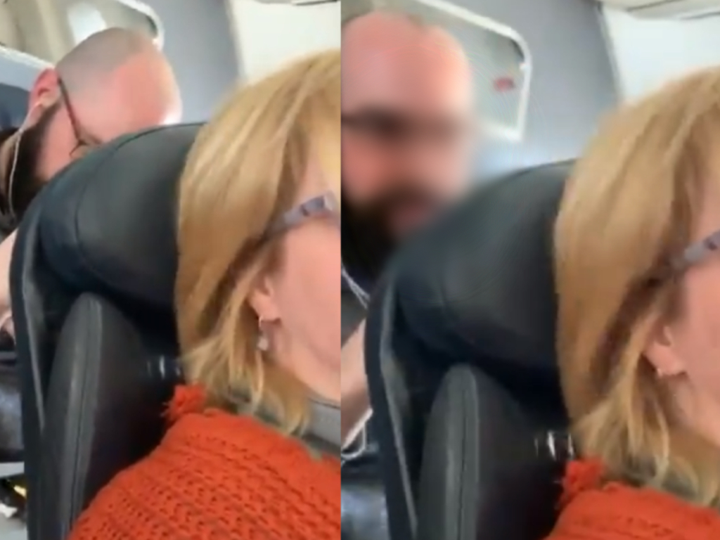 A woman shared a video to Twitter showing a man hitting the back of her seat after she reclined on an American Airlines flight.