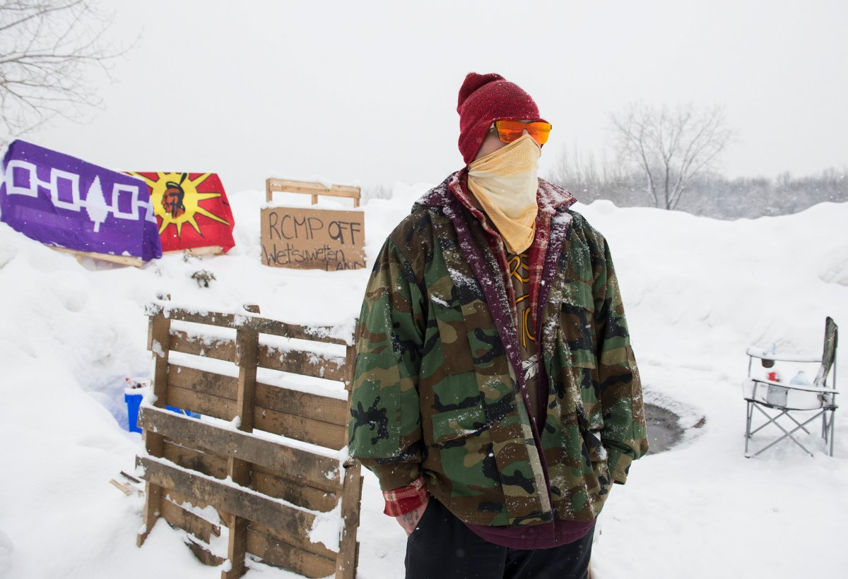 A member of the Mohawk community is seen on the Kahnawake reserve near a Canadian Pacific rail track south of Montreal, Monday, Feb. 10, 2020.