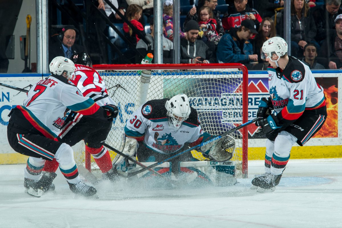 Seth Jarvis of the Portland Winterhawks scores a second period goal on Roman Basran of the Kelowna Rockets at Prospera Place on February 8, 2020.