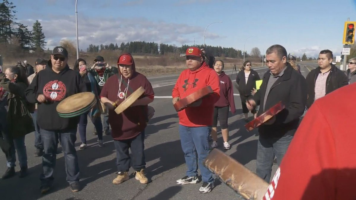 Indigenous demonstrators take to the centre of the Patricia Bay Highway in solidarity with Wet'suwet'en hereditary chiefs on Wednesday, Feb. 26, 2020.