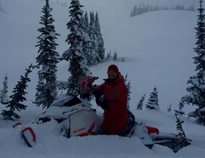 Sledder Sam Johnson pictured on a less eventful ride. Johnson  was partially buried by an avalanche on Saturday.